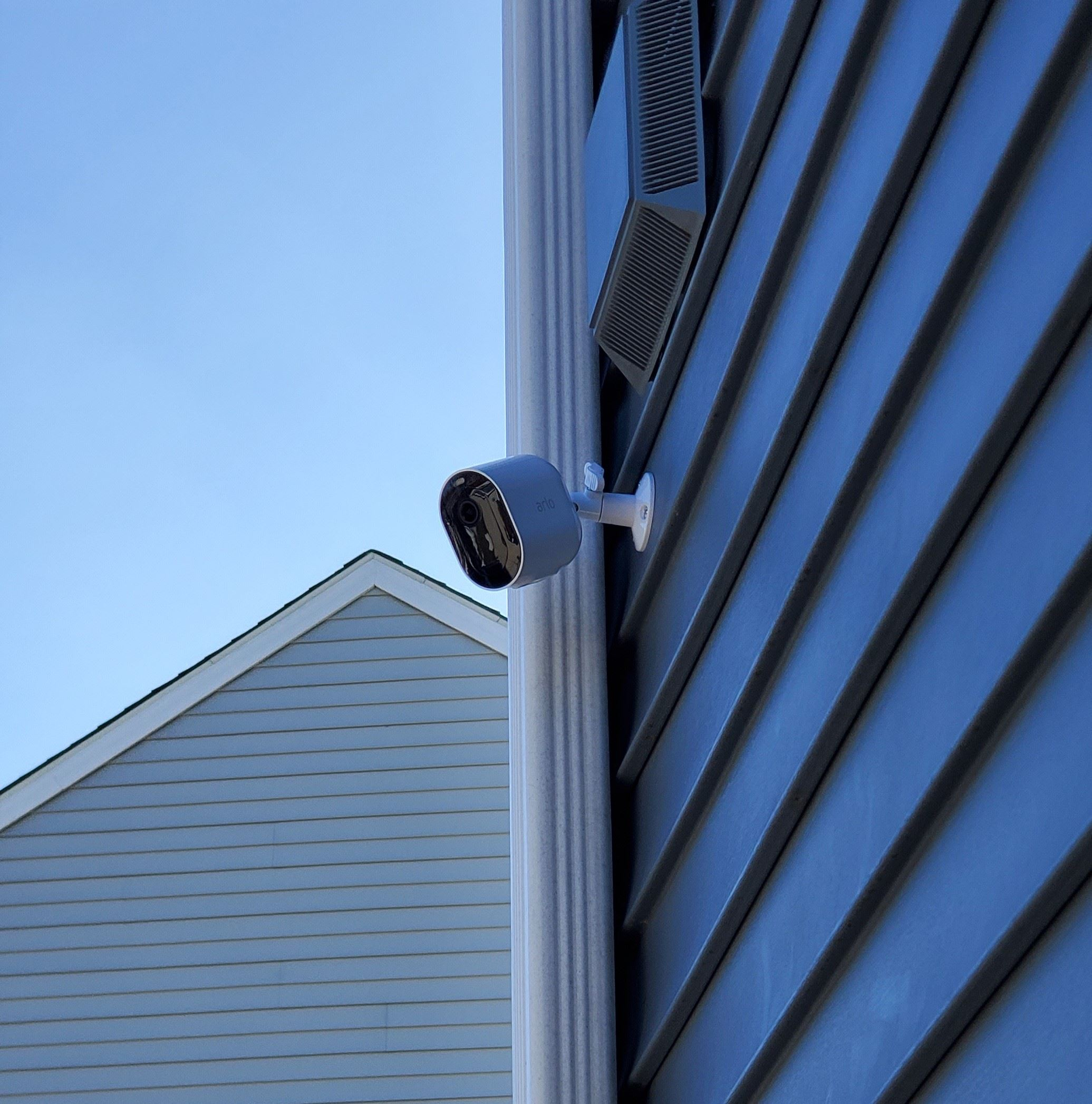 Security camera on blue house